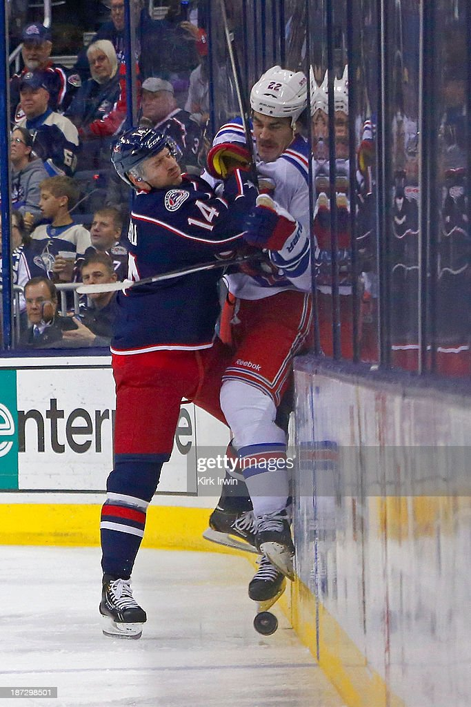 <a gi-track='captionPersonalityLinkClicked' href=/galleries/search?phrase=Blake+Comeau&family=editorial&specificpeople=879782 ng-click='$event.stopPropagation()'>Blake Comeau</a> #14 of the Columbus Blue Jackets checks Brian Boyle #22 of the New York Rangers into the boards while battling for control of the puck during the third period on November 7, 2013 at Nationwide Arena in Columbus, Ohio. New York defeated Columbus 4-2.