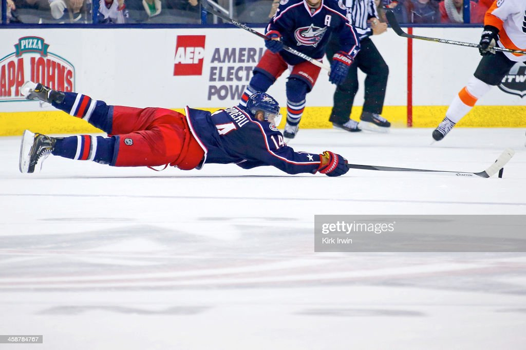 <a gi-track='captionPersonalityLinkClicked' href=/galleries/search?phrase=Blake+Comeau&family=editorial&specificpeople=879782 ng-click='$event.stopPropagation()'>Blake Comeau</a> #14 of the Columbus Blue Jackets dives to keep the puck in the offensive zone during the third period against the Philadelphia Flyers on December 21, 2013 at Nationwide Arena in Columbus, Ohio. Columbus defeated Philadelphia 6-3.