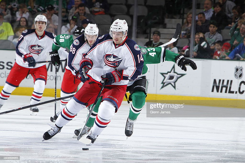 Blake Comeau #14 of the Columbus Blue Jackets handles the puck against the Dallas Stars at the American Airlines Center on April 9, 2014 in Dallas, Texas.