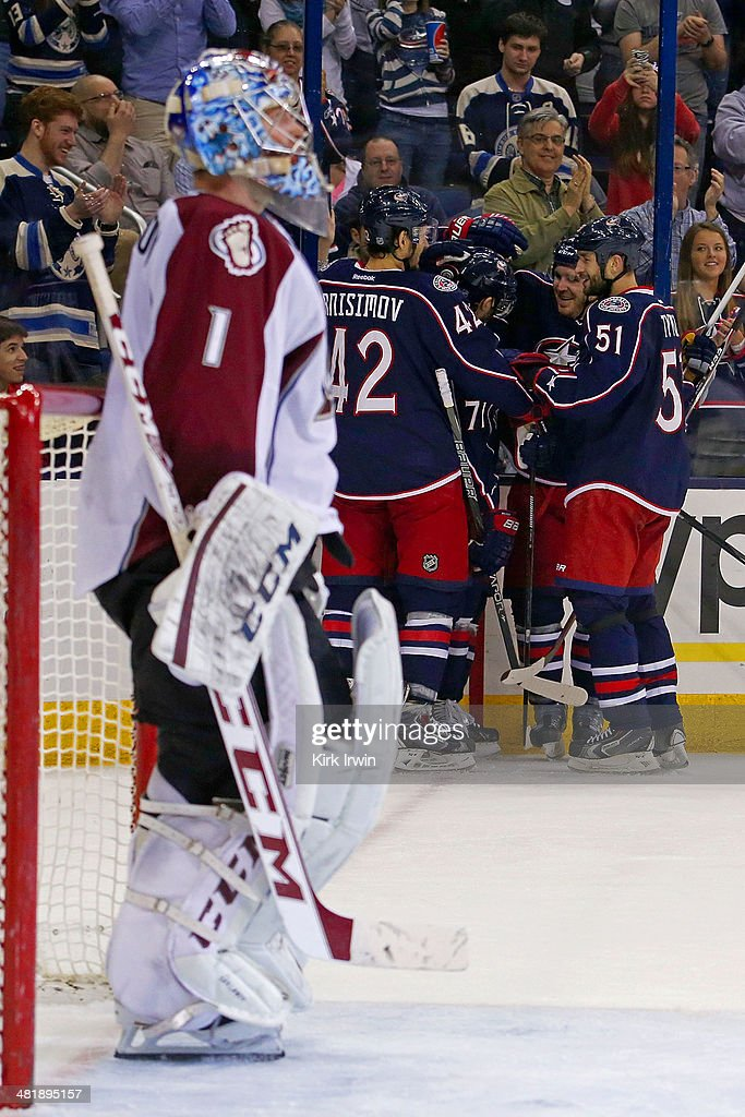 Blake Comeau #14 of the Columbus Blue Jackets is congratulated by his teammates after beating Semyon Varlamov #1 of the Colorado Avalanche for a goal during the second period on April 1, 2014 at Nationwide Arena in Columbus, Ohio.