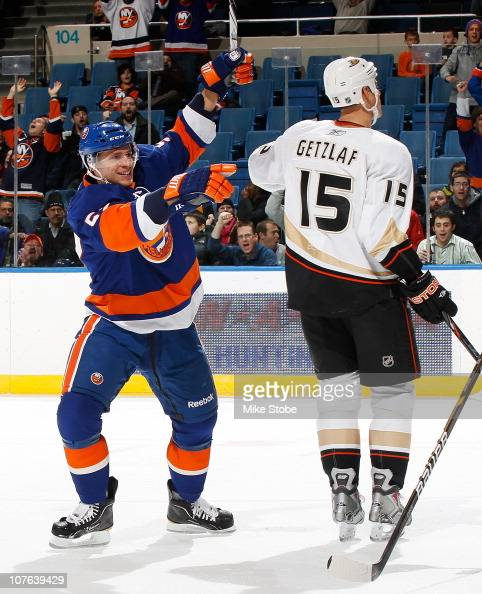 Blake Comeau of the New York Islanders celebrates his first period goal as Ryan Getzlaf of the Anaheim Ducks looks away on December 16 2010 at Nassau...