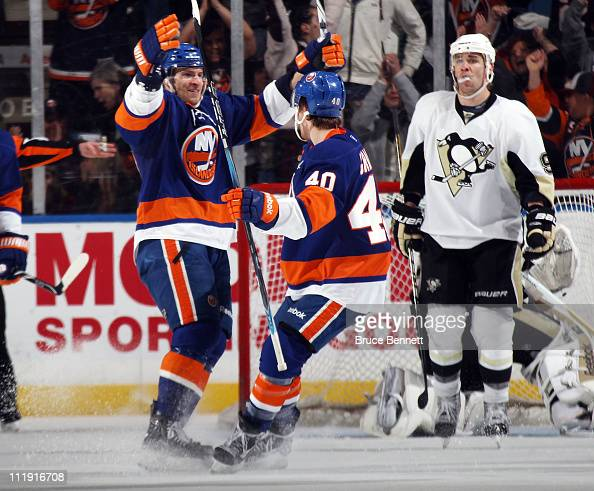 Blake Comeau of the New York Islanders celebrtes his goal at 814 of the third period along with Michael Grabner in their game against the Pittsburgh...