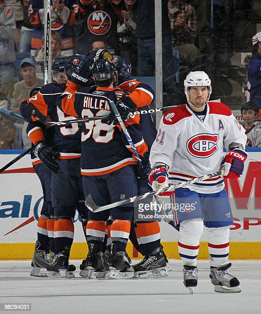 Blake Comeau of the New York Islanders scores at 1229 of the first period against the Montreal Canadiens as Brian Gionta returns to the bench at...