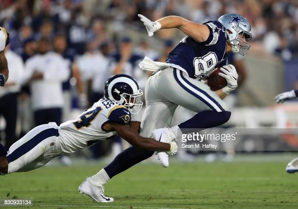 Blake Countess of the Los Angeles Rams tackles Blake Jarwin of the Dallas Cowboys during the second half of a presason game at Los Angeles Memorial...