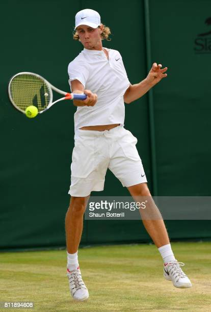 Blake Ellis of Australia plays a forehand during the Boy's Singles first round match against Trent Bryde of the United States on day seven of the...