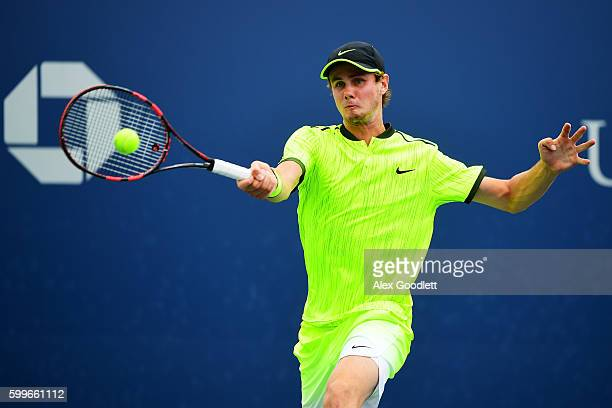 Blake Ellis of Australia returns a shot to Stefanos Tsitsipas of Greece during their Junior Boys' Singles Round Two Match on Day Nine of the 2016 US...