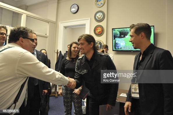 Blake Farenthold Zac Hanson and Isaac Hanson speak during a meeting during the Grammy's on the hill lobbying day at Cannon House Office Building on...