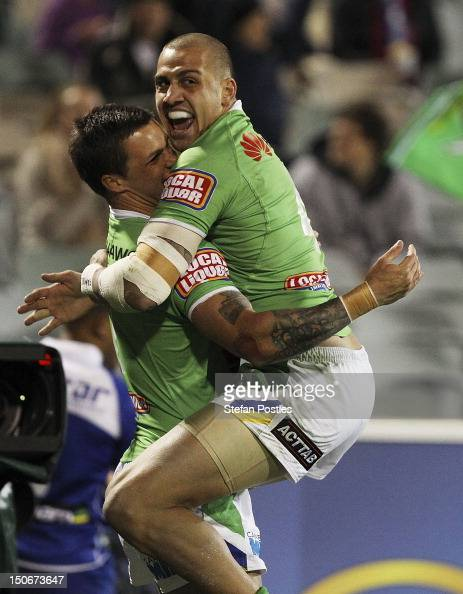 Blake Ferguson congratulates Sandor Earl of the Raiders after he scored a try during the round 25 NRL match between the Canberra Raiders and the...