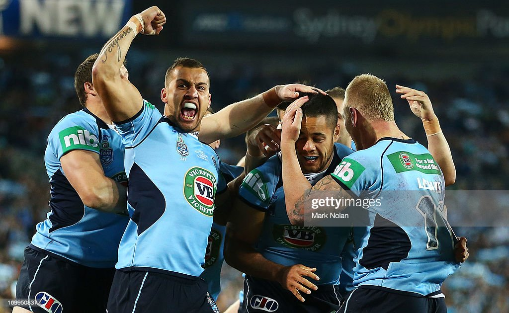 Blake Ferguson, <a gi-track='captionPersonalityLinkClicked' href=/galleries/search?phrase=Jarryd+Hayne&family=editorial&specificpeople=563352 ng-click='$event.stopPropagation()'>Jarryd Hayne</a> and <a gi-track='captionPersonalityLinkClicked' href=/galleries/search?phrase=Luke+Lewis&family=editorial&specificpeople=243041 ng-click='$event.stopPropagation()'>Luke Lewis</a> of the Blues celebrate a try by <a gi-track='captionPersonalityLinkClicked' href=/galleries/search?phrase=Jarryd+Hayne&family=editorial&specificpeople=563352 ng-click='$event.stopPropagation()'>Jarryd Hayne</a> during game one of the ARL State of Origin series between the New South Wales Blues and the Queensland Maroons at ANZ Stadium on June 5, 2013 in Sydney, Australia.