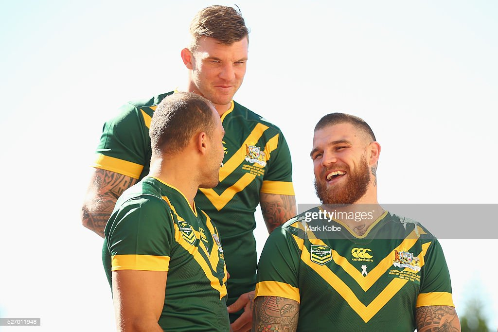 <a gi-track='captionPersonalityLinkClicked' href=/galleries/search?phrase=Blake+Ferguson+-+Rugby+Player&family=editorial&specificpeople=11188731 ng-click='$event.stopPropagation()'>Blake Ferguson</a>, Josh McGuire and <a gi-track='captionPersonalityLinkClicked' href=/galleries/search?phrase=Josh+Dugan&family=editorial&specificpeople=5553377 ng-click='$event.stopPropagation()'>Josh Dugan</a> share a joke as they pose for the team photo during the Australia Kangaroos Test team photo session at Crowne Plaza Coogee on May 2, 2016 in Sydney, Australia.