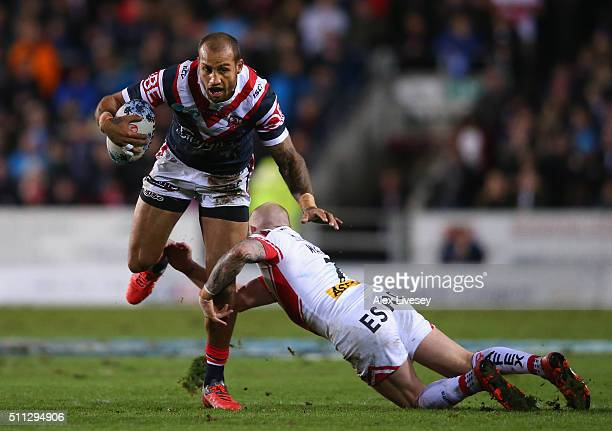 Blake Ferguson of Sydney Roosters is tackled by Luke Walsh of St Helens during the World Club Series match between St Helens and Sydney Roosters at...