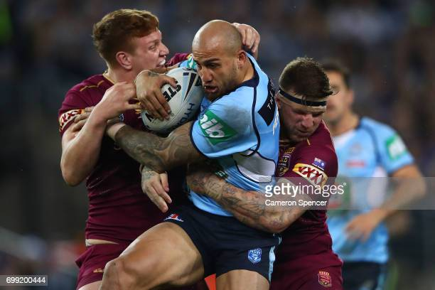 Blake Ferguson of the Blues is tackled during game two of the State Of Origin series between the New South Wales Blues and the Queensland Maroons at...