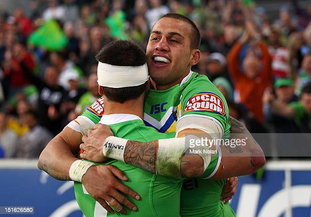 Blake Ferguson of the Raiders celebrates scoring a try with team mate Sandor Earl during the Second NRL Elimination Final match between the Canberra...
