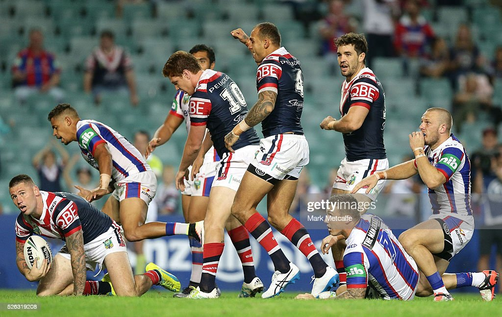 <a gi-track='captionPersonalityLinkClicked' href=/galleries/search?phrase=Blake+Ferguson+-+Rugby+Player&family=editorial&specificpeople=11188731 ng-click='$event.stopPropagation()'>Blake Ferguson</a> of the Roosters celebrates scoring a try during the round nine NRL match between the Sydney Roosters and the Newcastle Knights at Allianz Stadium on April 30, 2016 in Sydney, Australia.