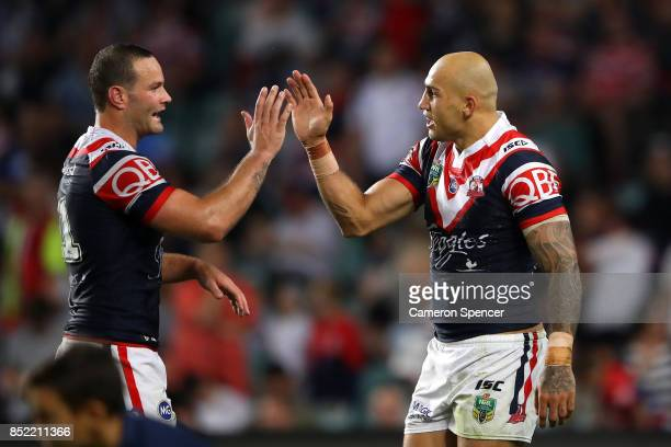 Blake Ferguson of the Roosters celebrates scoring a try with team mate Boyd Cordner of the Roosters during the NRL Preliminary Final match between...