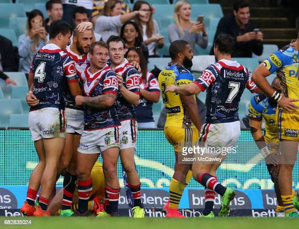 Blake Ferguson of the Roosters celebrates with teammates after scoring a try during the round 10 NRL match between the Sydney Roosters and the...