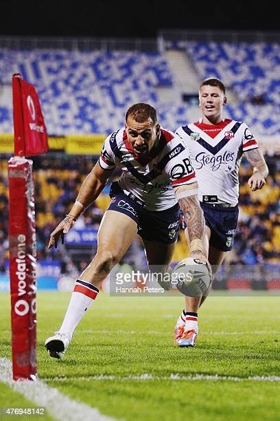 Blake Ferguson of the Roosters dives over to score the winning try during the round 14 NRL match between the New Zealand Warriors and the Sydney...