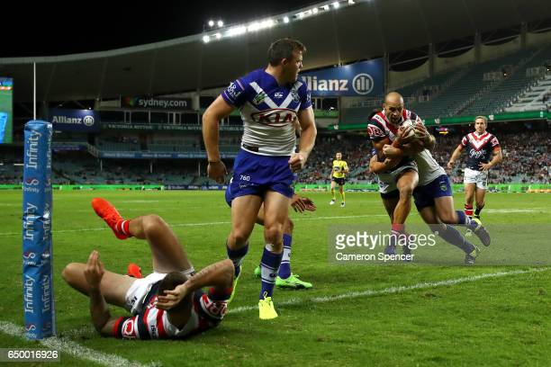 Blake Ferguson of the Roosters heads for the tryline during the round two NRL match between the Sydney Roosters and the Canterbury Bulldogs at...