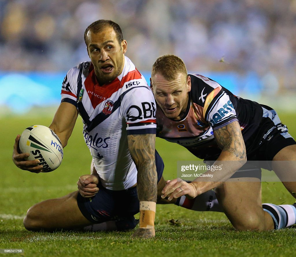 Blake Ferguson of the Roosters is tackled by Luke Lewis of the Sharks during the round 25 NRL match between the Cronulla Sharks and the Sydney Roosters at Shark Park on August 27, 2016 in Sydney, Australia.