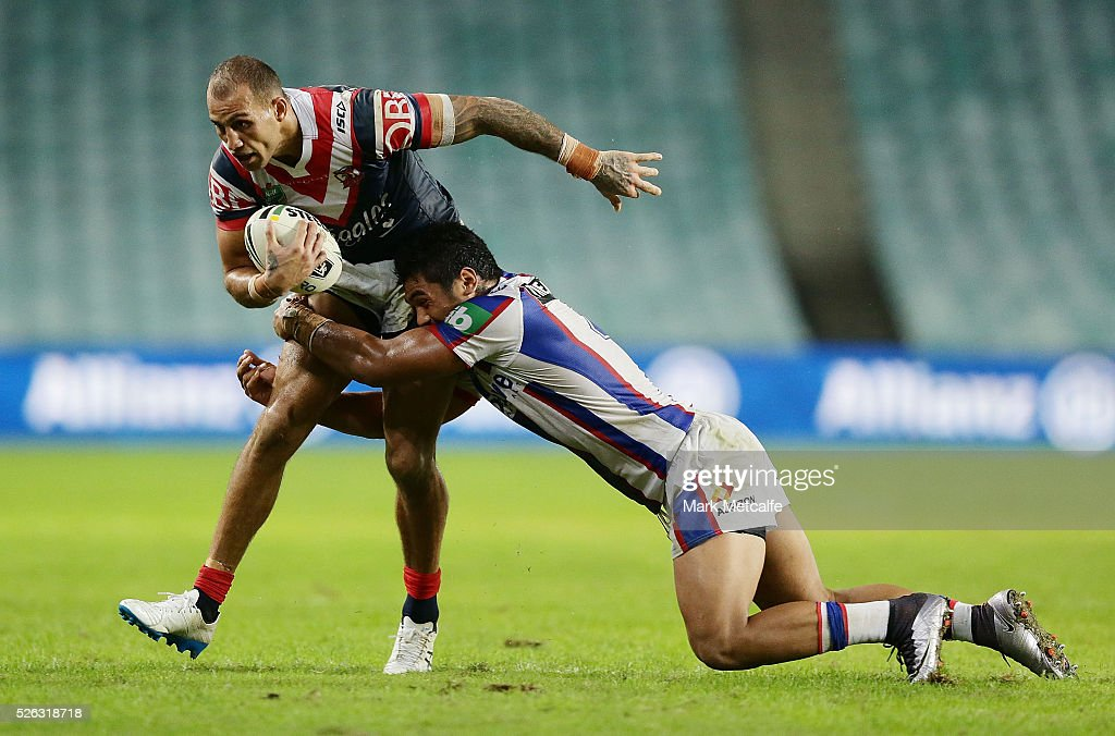 <a gi-track='captionPersonalityLinkClicked' href=/galleries/search?phrase=Blake+Ferguson+-+Rugby+Player&family=editorial&specificpeople=11188731 ng-click='$event.stopPropagation()'>Blake Ferguson</a> of the Roosters is tackled by Pat Mata'utia of the Knights during the round nine NRL match between the Sydney Roosters and the Newcastle Knights at Allianz Stadium on April 30, 2016 in Sydney, Australia.