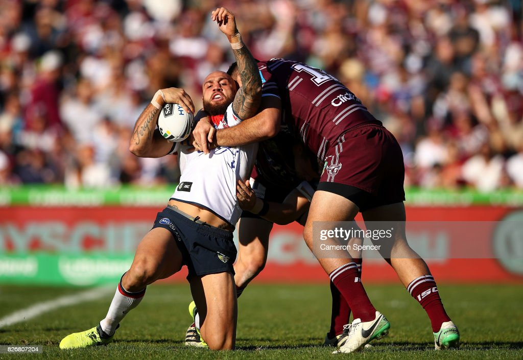Blake Ferguson of the Roosters is tackled during the round 22 NRL match between the Manly Warringah Sea Eagles and the Sydney Roosters at Lottoland on August 6, 2017 in Sydney, Australia.