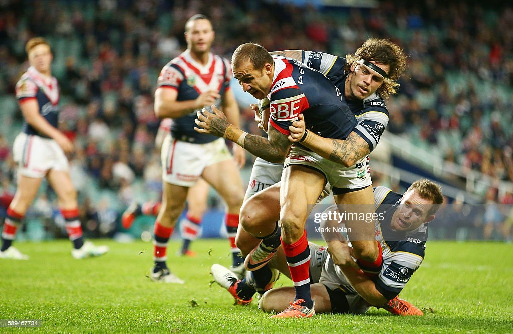 Blake Ferguson of the Roosters runs the ball during the round 23 NRL match between the Sydney Roosters and the North Queensland Cowboys at Allianz Stadium on August 14, 2016 in Sydney, Australia.