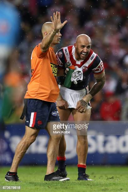 Blake Ferguson of thre The Roosters receives attention from the trainer during the round eight NRL match between the Sydney Roosters and the St...
