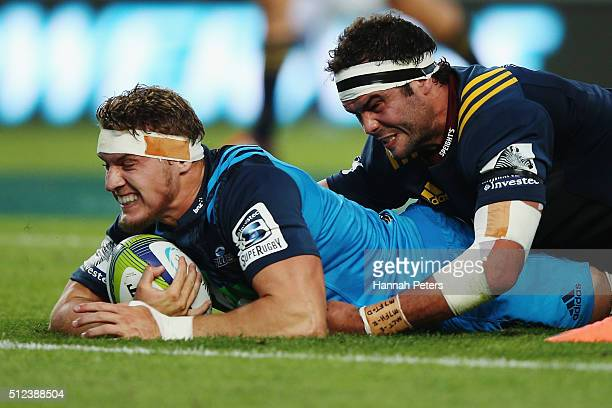 Blake Gibson of the Blues dives over to score a try during the round one Super Rugby match between the Blues and the Highlanders at Eden Park on...