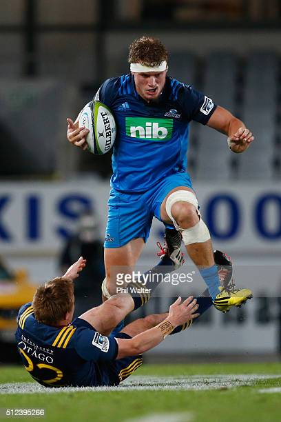 Blake Gibson of the Blues is tackled by Hayden Parker of the Highlanders during the round one Super Rugby match between the Blues and the Highlanders...