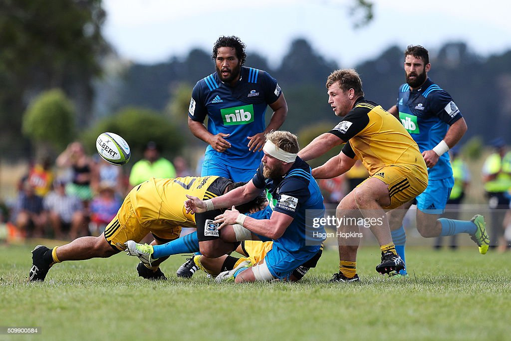 Blake Gibson of the Blues offloads during the Super Rugby pre-season match between the Blues and the Hurricanes at Eketahuna Rugby Club on February 13, 2016 in Eketahuna, New Zealand.