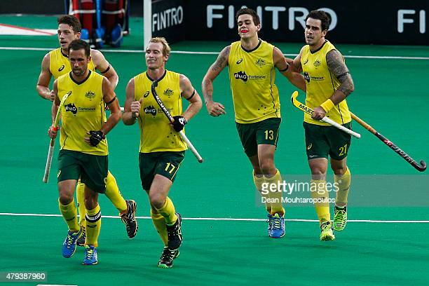 Blake Govers of Australia celebrates with team mates after he scores a goal during the Fintro Hockey World League SemiFinal match between Australia...
