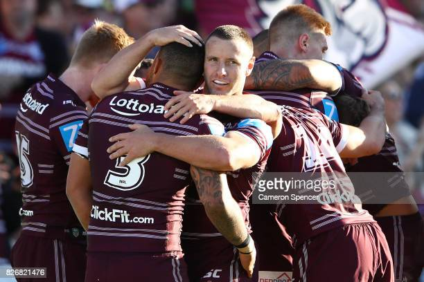 Blake Green of the Sea Eagles celebrates with team mates after a try by Daly CherryEvans of the Sea Eagles during the round 22 NRL match between the...