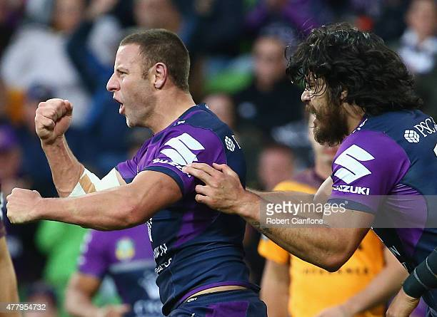Blake Green of the Storm celebrates after scoring a try during the round 15 NRL match between the Melbourne Storm and the Brisbane Broncos at AAMI...