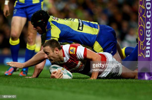Blake Green of Wigan scores his team's fourth try during the Super League Grand Final between Warrington Wolves and Wigan Warriors at Old Trafford on...