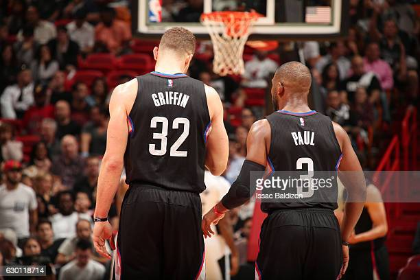 Blake Griffin and Chris Paul of the LA Clippers take the court during a game against the Miami Heat on December 16 2016 at American Airlines Arena in...