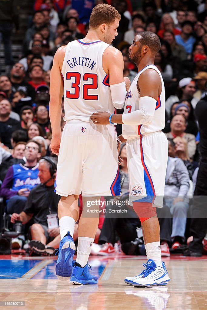 Blake Griffin #32 and Chris Paul #3 of the Los Angeles Clippers speak during a game against the Milwaukee Bucks at Staples Center on March 6, 2013 in Los Angeles, California.