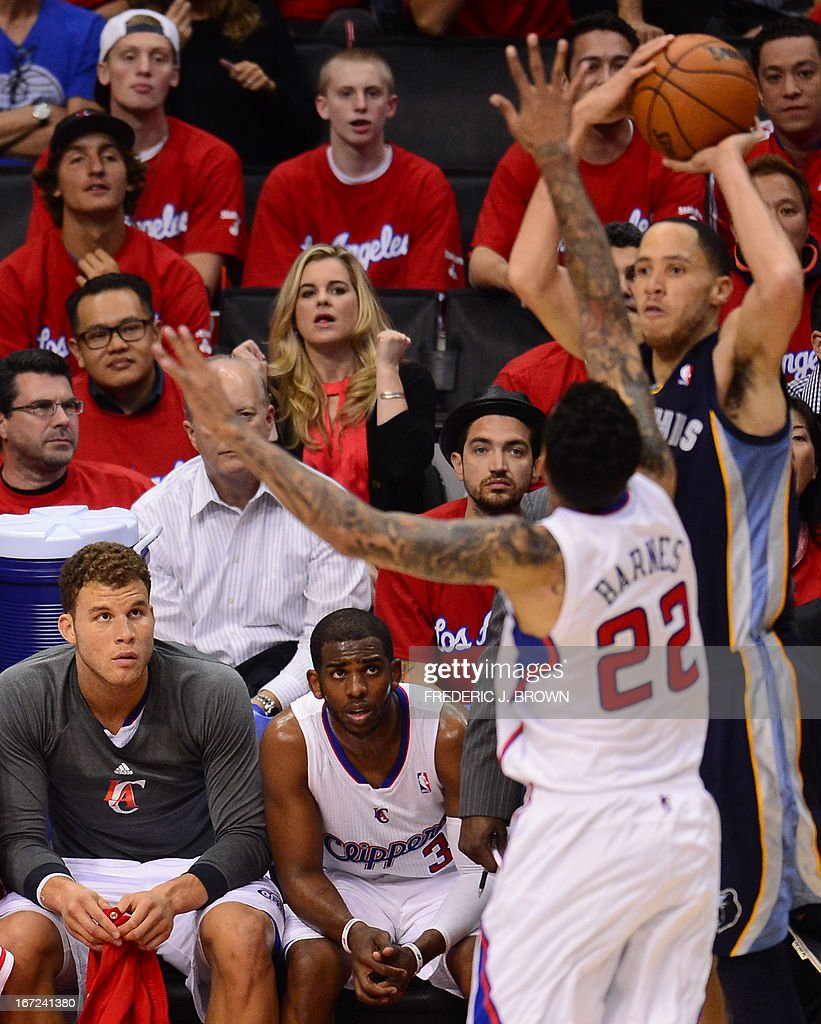 Blake Griffin (L) and Chris Paul (2/L) of the Los Angeles Clippers watch from the bench as teammate Matt Barnes (2/R) covers Tayshaun Prince (R) of the Memphis Grizzlies during game two of their NBA Basketball playoff series at Staples Center in Los Angeles, California on April 22, 2013. AFP PHOTO / Frederic J. BROWN