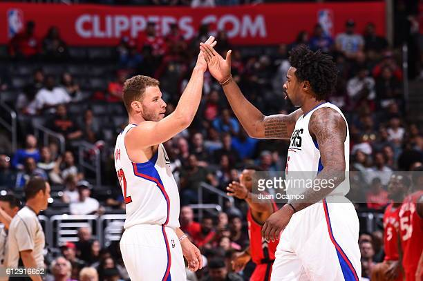 Blake Griffin and DeAndre Jordan of the Los Angeles Clippers celebrate against the Toronto Raptors on October 5 2016 at STAPLES Center in Los Angeles...