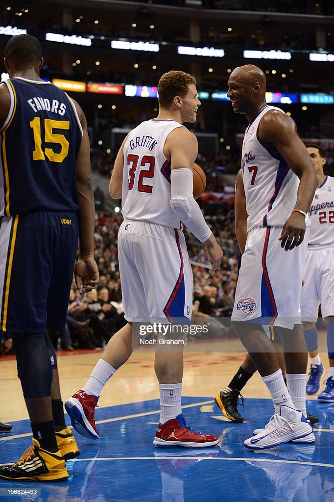 Blake Griffin #32 and Lamar Odom #7 of the Los Angeles Clippers share a laugh during the game between the Los Angeles Clippers and the Utah Jazz at Staples Center on December 30, 2012 in Los Angeles, California.