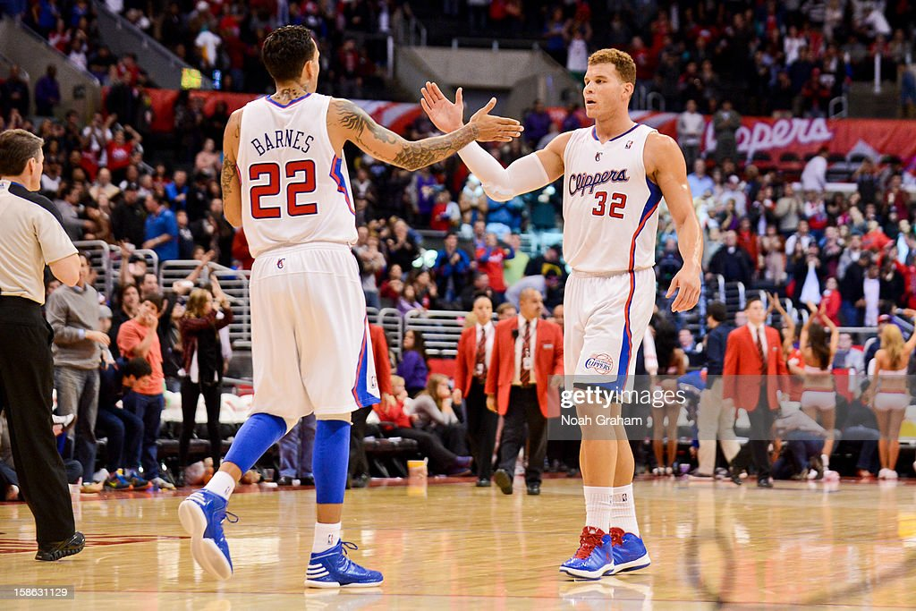 Blake Griffin #32 and Matt Barnes #22 of the Los Angeles Clippers celebrate during their game against the Sacramento Kings at Staples Center on December 21, 2012 in Los Angeles, California.