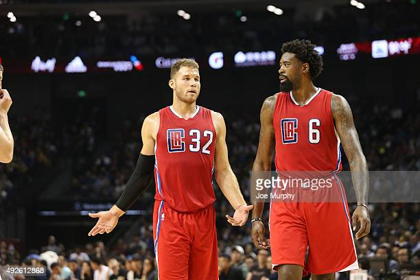 Blake Griffin chats with DeAndre Jordan of the Los Angeles Clippers in the game against the Charlotte Hornets as part of the 2015 NBA Global Games...