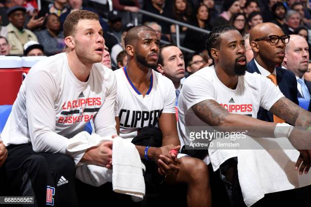 Blake Griffin Chris Paul and DeAndre Jordan of the Los Angeles Clippers look on during the game against the Houston Rockets on March 1 2017 at...