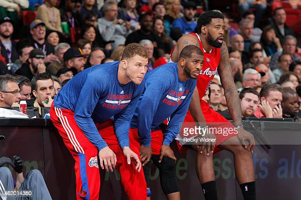 Blake Griffin Chris Paul and DeAndre Jordan of the Los Angeles Clippers wait to check into the game against the Sacramento Kings on January 17 2015...