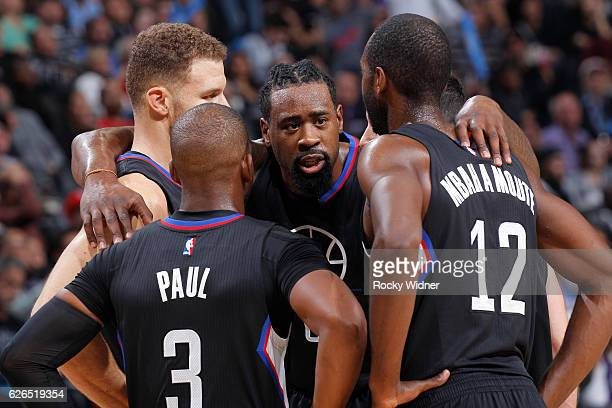 Blake Griffin Chris Paul DeAndre Jordan and Luc Mbah a Moute of the Los Angeles Clippers huddle up during the game against the Sacramento Kings on...