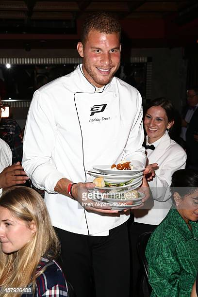 Blake Griffin helps to clear plates from the table during The CP3 Foundation's Celebrity Server Dinner presented by Apollo Jets at Mastro's...
