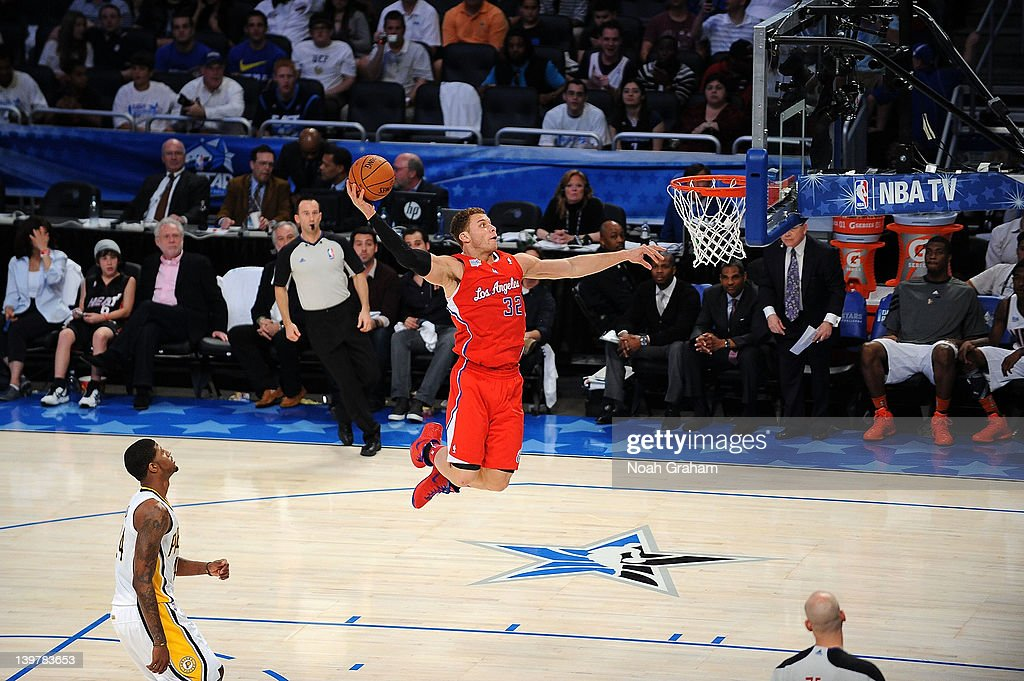 Blake Griffin of Team Shaq dunks against Paul George of Team Chuck during the BBVA Rising Stars Challenge as part of 2012 AllStar Weekend at the...