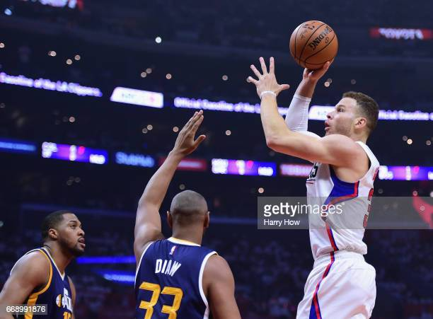 Blake Griffin of the LA Clippers attempts a shot over Boris Diaw and Derrick Favors of the Utah Jazz during a 9795 Jazz win during the first half at...