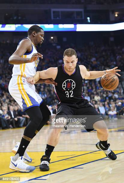 Blake Griffin of the LA Clippers dribbles the ball while defended by Kevin Durant of the Golden State Warriors during an NBA basketball game at...