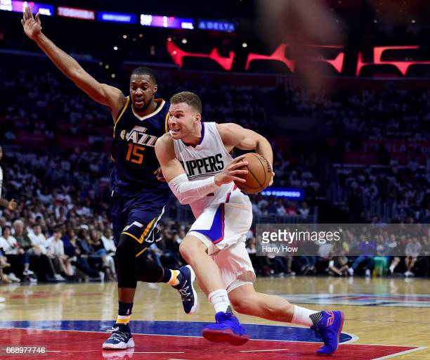 Blake Griffin of the LA Clippers drives on Derrick Favors of the Utah Jazz during the first half at Staples Center on April 15 2017 in Los Angeles...