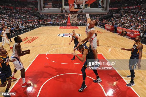 Blake Griffin of the LA Clippers dunks the ball while guarded by Rudy Gobert of the Utah Jazz on October 24 2017 at STAPLES Center in Los Angeles...